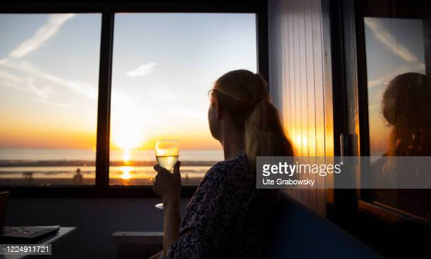 In this photo illustration a woman is looking at the sunset on June 24, 2020 in Oostkapelle, Netherlands.