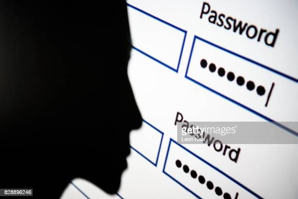 In this photo illustration A woman is silhouetted against a projection of a password login dialog box on August 09 2017 in London England With so...