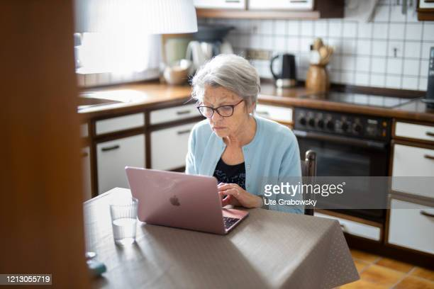 In this photo illustration a woman is using a laptop on May 12, 2020 in Radevormwald, Germany.