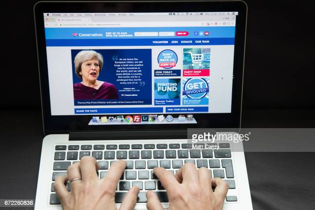 In this photo illustration a woman looks at the Conservative party website on a laptop computer on April 24, 2017 in Bristol, England. The use of...