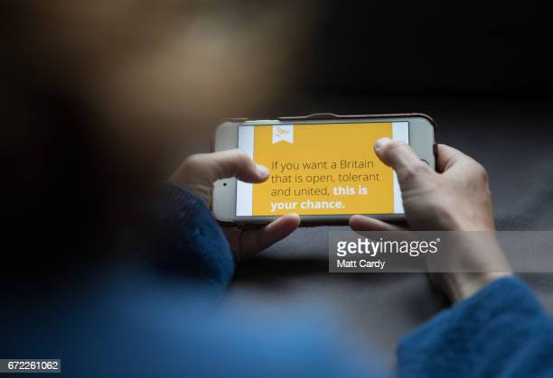 In this photo illustration a woman looks at the Liberal Democrat party mobile website on a iPhone on April 24 2017 in Bristol England The use of...