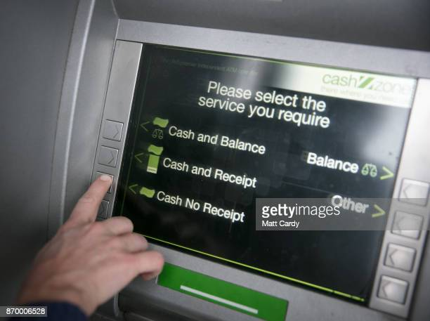 In this photo illustration a woman uses a cashpoint ATM on November 3 2017 in Bristol England The Bank of England raised interest rates from a...