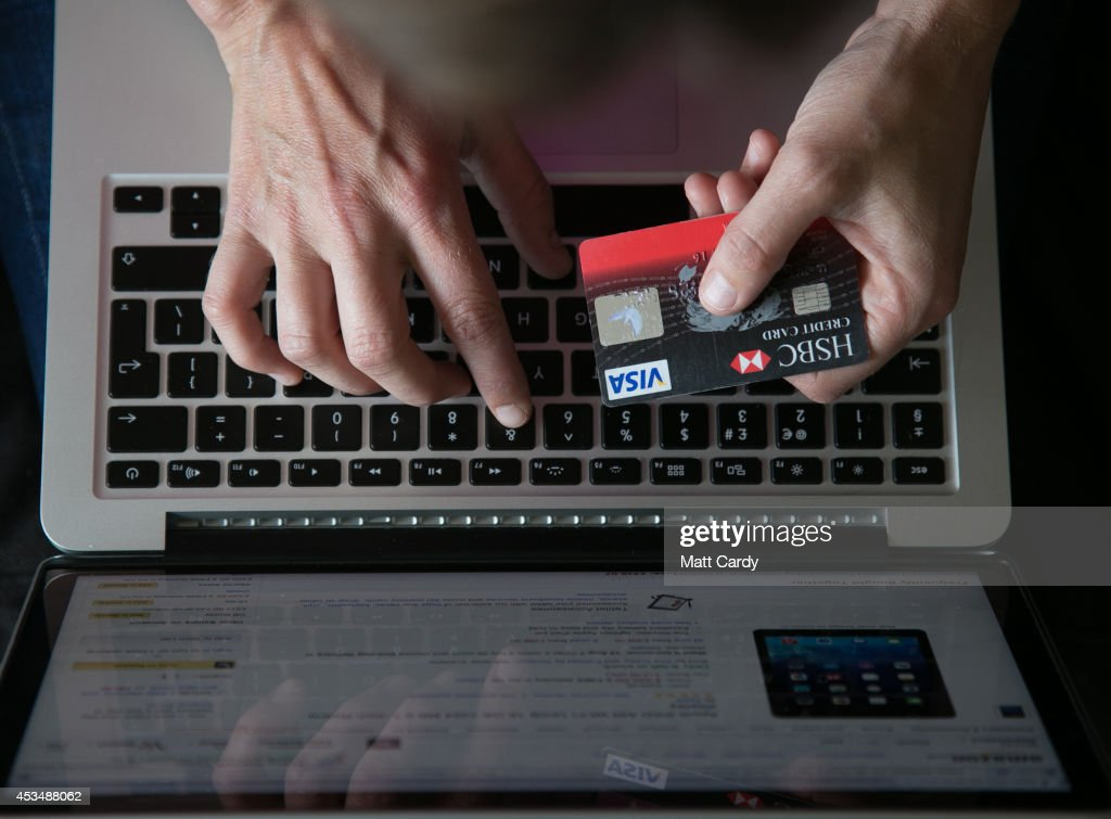 In this photo illustration a woman uses a credit card to buy something online on August 11, 2014 in Bristol, United Kingdom. This week marks the 20th anniversary of the first online sale. Since that sale - a copy of an album by the artist Sting - online retailing has grown to such an extent that it is now claimed that 95 percent of the UK population has shopped online and close to one in four deciding to shop online each week.