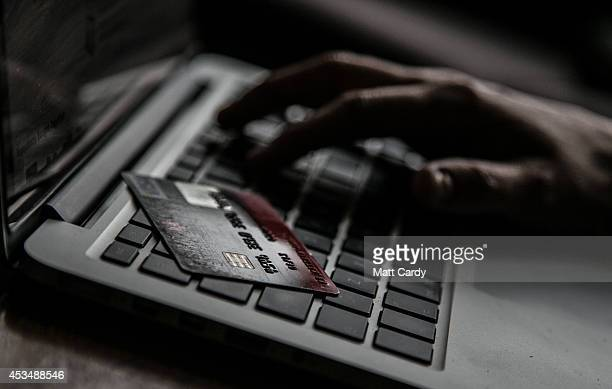 In this photo illustration a woman uses a credit card to buy something online on August 11 2014 in Bristol United Kingdom This week marks the 20th...