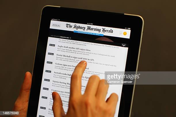 In this photo illustration a woman uses the Sydney Morning Herald app on an iPad on June 20 2012 in Sydney Australia Fairfax media group this week...
