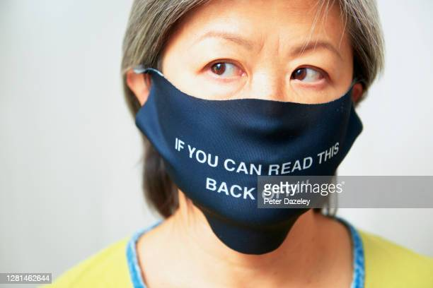 In this photo illustration a woman wears a mask with If you can read this back off on October 212020 in Kingston On Thames England