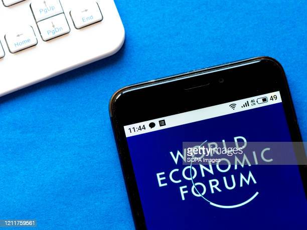 In this photo illustration a World Economic Forum logo seen displayed on a smartphone.