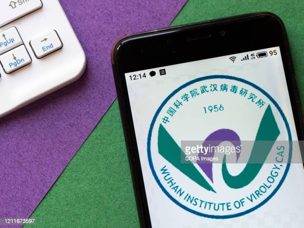 In this photo illustration a Wuhan Institute of Virology logo seen displayed on a smartphone.
