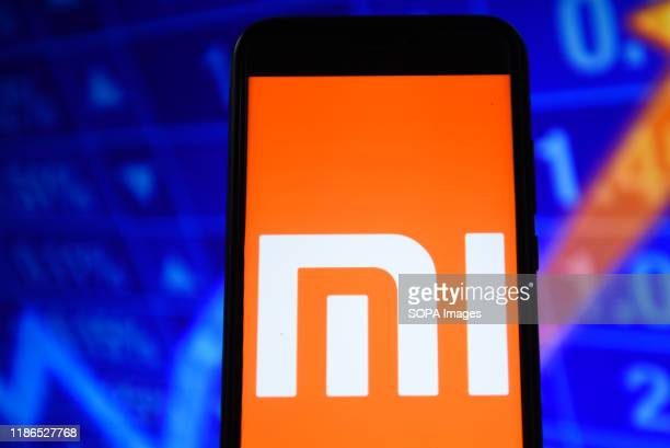 In this photo illustration a Xiaomi logo seen displayed on a smartphone.