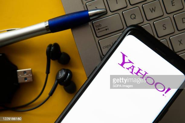 In this photo illustration a Yahoo logo seen displayed on a smartphone.