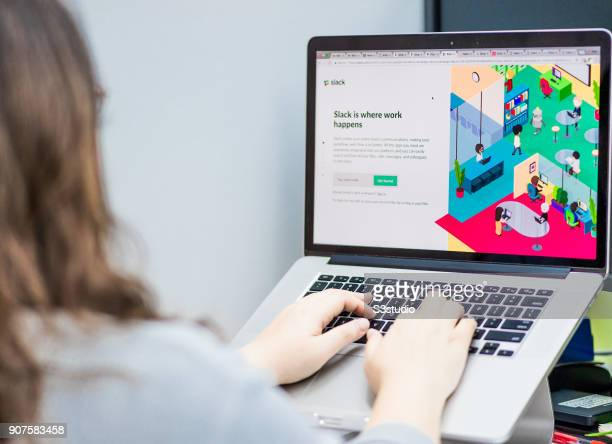 In this photo illustration, a young lady using a Mac book pro as she uses Slack website on January 18, 2017 in Hong Kong, Hong Kong.