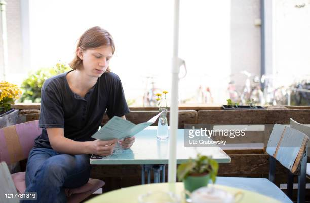 In this photo illustration a young man is taking his decision in a tiny cafe on May 29 2020 in Bonn Germany