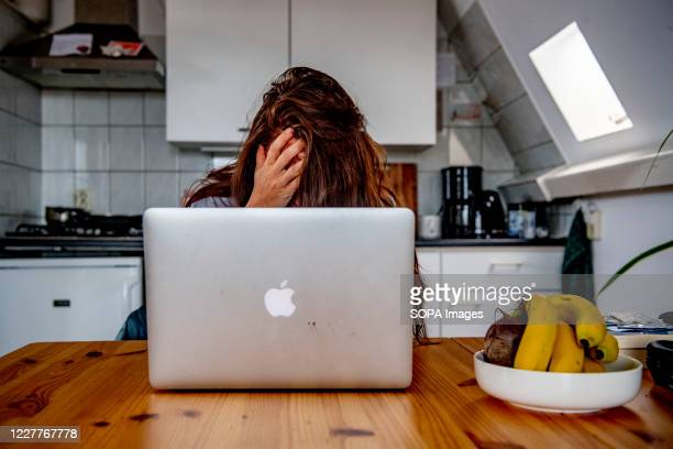 In this photo illustration, a young woman looking for a job during the coronavirus crisis. The number of unemployed in the Netherlands rose by 74,000...