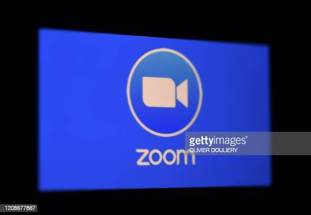 In this photo illustration a Zoom App logo is displayed on a smartphone on March 30 2020 in Arlington Virginia The Zoom video meeting and chat app...