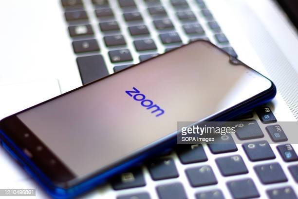 In this photo illustration a Zoom Video Communications logo seen displayed on a smartphone.