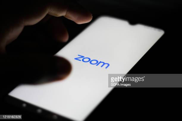 In this photo illustration a Zoom Video logo seen displayed on a smartphone.