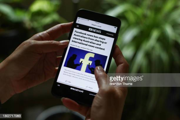 In this photo illustration ABC News reports on Facebook's news ban on Australian and International content on February 18, 2021 in Sydney, Australia....