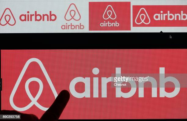 In this photo illustration Airbnb logo is displayed on a laptop screen on December 11 2017 in Paris France Paris City Hall has asked Airbnb and four...