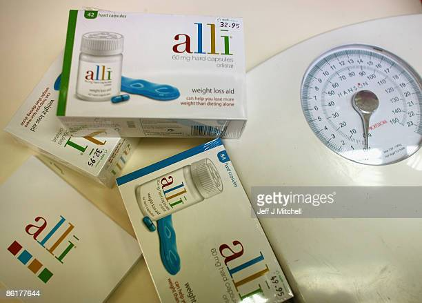 In this photo illustration Alli slimming pills are stocked at G W Allan chemists on April 23 2009 in Edinburgh Scotland The slimming pill now...