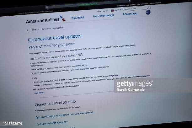 In this photo illustration American Airlines advises customers of its current flight status on March 19 2020 in Essex England Many highstreet shops...