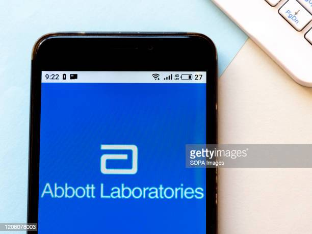 In this photo illustration an Abbott Laboratories logo seen displayed on a smartphone