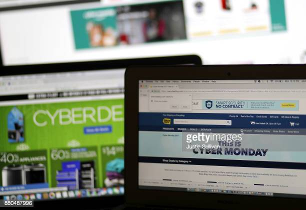 In this photo illustration an ad seen on the Best Buy website for a Cyber Monday sale is displayed on laptop computers on November 27 2017 in San...