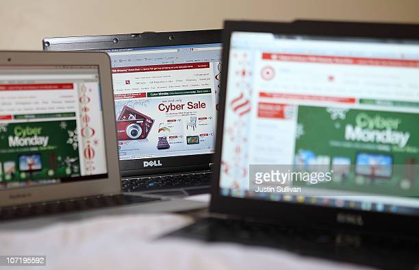 In this photo illustration, an ad seen on the Target website for a Cyber Monday sale is displayed on laptop computers on November 29, 2010 in San...