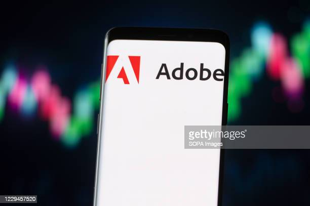 In this photo illustration an Adobe logo seen displayed on a smartphone.
