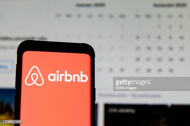 In this photo illustration an Airbnb logo seen displayed on a smartphone