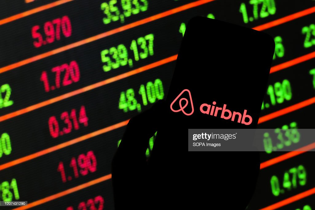 In this photo illustration an Airbnb logo seen displayed on... : News Photo