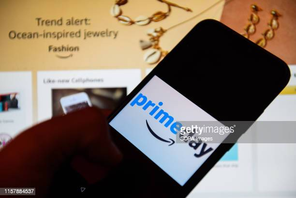 In this photo illustration an Amazon Prime day logo seen displayed on a smartphone.