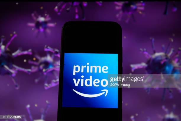 In this photo illustration an Amazon Prime Video logo displayed on a smartphone with a COVID 19 sample image in the background