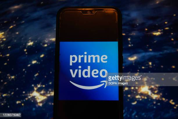 In this photo illustration an Amazon Prime Video logo displayed on a smartphone
