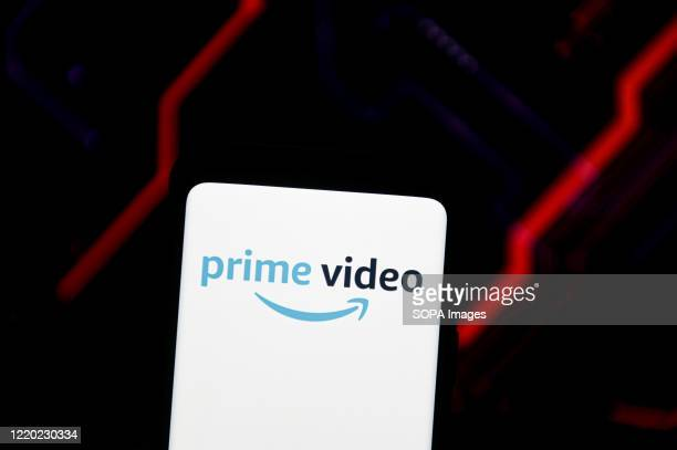 In this photo illustration an Amazon Prime Video logo seen displayed on a smartphone