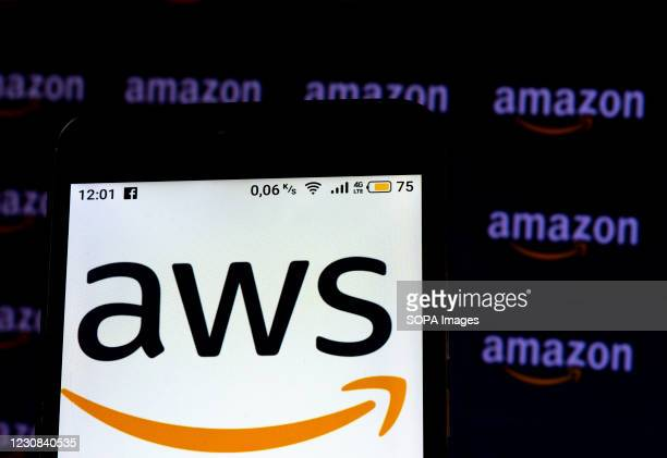 In this photo illustration an Amazon Web Services logo seen displayed on a smartphone screen.