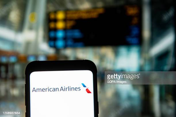 In this photo illustration an American Airlines logo seen displayed on a smartphone