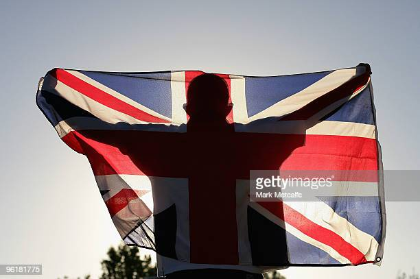 In this photo illustration an Andy Murray fan holds the Union Jack flag aloft on the steps of Rod Laver Arena before the quarterfinal match between...