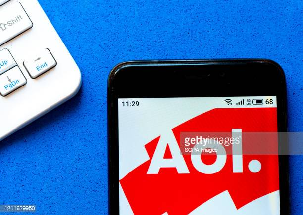 In this photo illustration an AOL logo seen displayed on a smartphone.