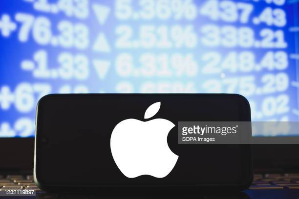 In this photo illustration an Apple logo seen displayed on a smartphone.