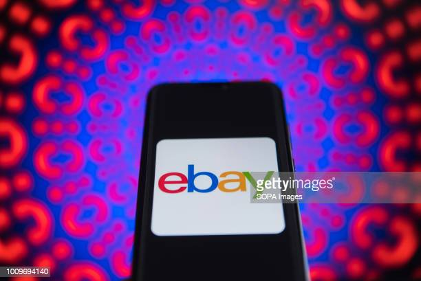 In this photo illustration an Ebay logo is seen displayed on a mobile phone
