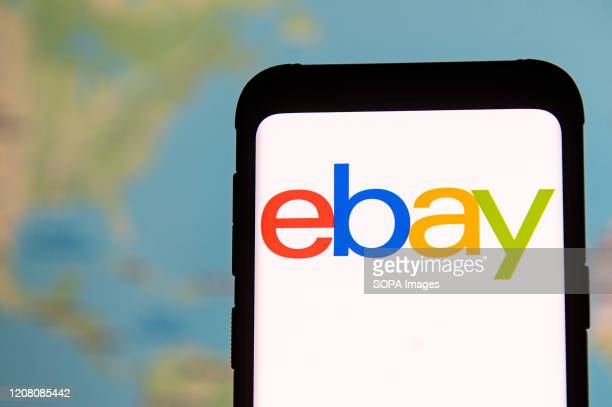In this photo illustration an Ebay logo seen displayed on a smartphone