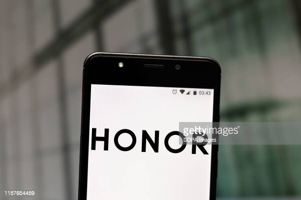 In this photo illustration an Honor logo seen displayed on a smartphone.
