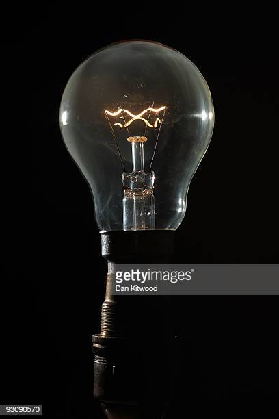 In this photo illustration an incandescent light bulb is illuminated on November 16 2009 in London England As world leaders prepare to gather for the...