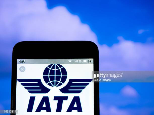 In this photo illustration an International Air Transport Association logo is seen displayed on a smartphone.
