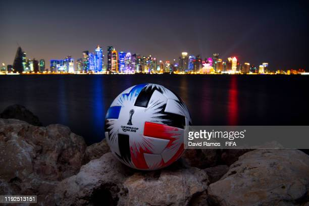 In this photo illustration an Official FIFA Club World Cup Qatar 2019 ball sits on display in front of the skyline of Doha on December 07, 2019 in...
