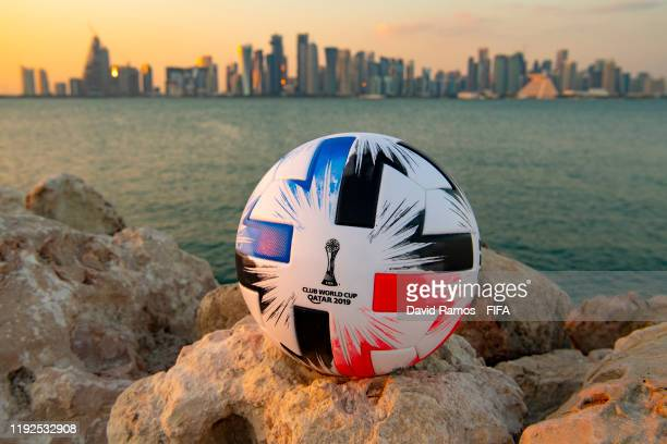 In this photo illustration an Official FIFA Club World Cup Qatar 2019 ball sits on display in front of the skyline of Doha on December 07 2019 in...