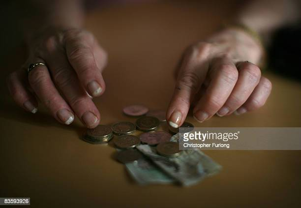 In this photo illustration an old age pensioner checks what is left of her weekly state pension on November 6 in Conwy Wales With the recent high...