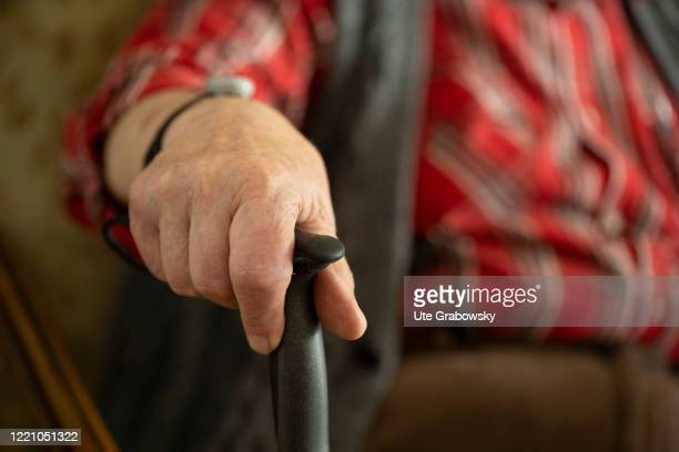 In this photo illustration an old man is holding a walking stick on June 11, 2020 in Bonn, Germany.