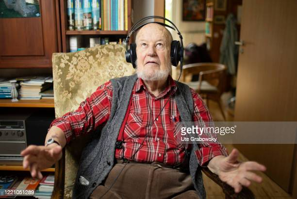 In this photo illustration an old man is listening to music with Headphones on June 11, 2020 in Bonn, Germany.