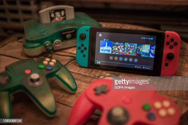 In this photo illustration, an old vintage Japanese market version of the Nintendo 64 video game console knows also as 'N64' released in 1996 in...